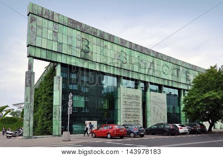 WARSAW, POLAND - JUNE 8, 2015: Modern library of Warsaw University. Glass facade with metal aged frame and green roof. Poland on June 2015.