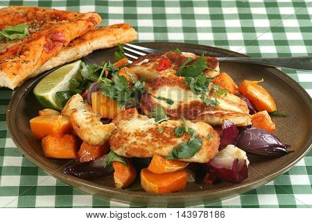 grilled haloumi cheese wit roast onion and sweet potato