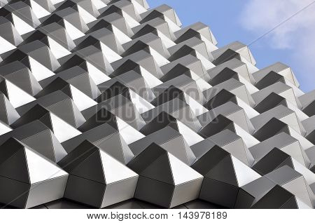 DRESDEN, GERMANY - APRIL 12 2016: Fragment of the facade of a modern shopping center. Metal mesh structure. Look up. Dresden, Saxony, Germany.