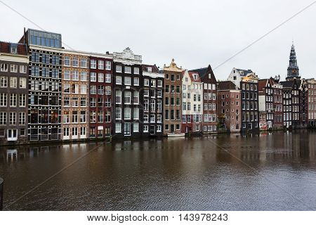 Amsterdam Netherlands - July 01 2016: View of the traditional Dutch houses with reflection in water