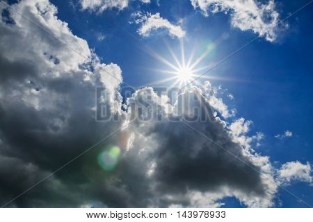Blue sky with clouds and sun rays beautiful