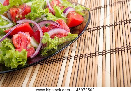 Close-up View Of The Tabletop And A Plate Of Fresh  Salad