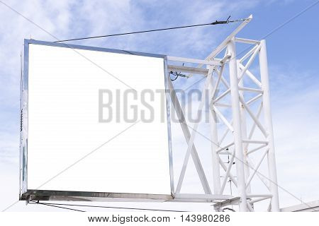 The advertisement board hanging on the building structure with blue sky
