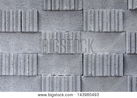 The stack of the cement block.The texture of the concrete block stack in the storage.