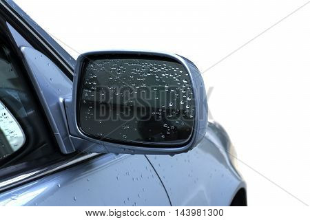 rain drop on rearview mirror on the car with white background