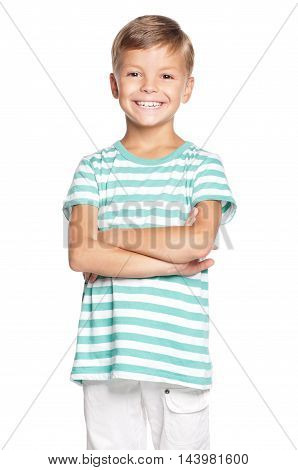 Portrait of proud young boy. Happy cute kid with arms folded. Smiling schoolboy isolated on white background.