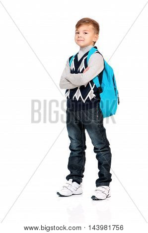 Cute teenager boy with backpack. Smiling schoolboy with bag isolated on white background. Full height portrait happy child. Back to school.