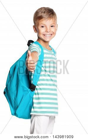 Smiling school boy with backpack standing and showing thumb up sign. Smiling child isolated on white background.
