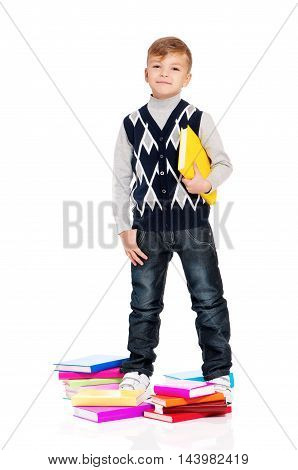 Cute teenager boy with books. Smiling schoolboy isolated on white background. Full height portrait happy child. Back to school.