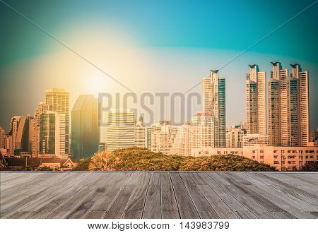Bangkok city downtown with wooden walkway at daytime in Thailand. Vintage tone