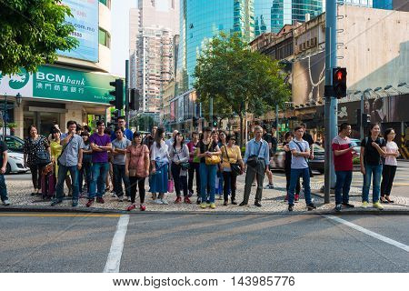 Macau China - OCTOBER 22 2015 - A big crowd of people in the main square of Macau downtown evening in Macau China Asia.