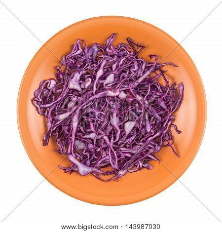 Shredded red cabbage in a plate. Top view.