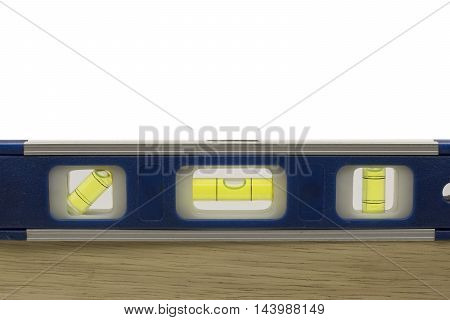 spirit level on wooden work with white background