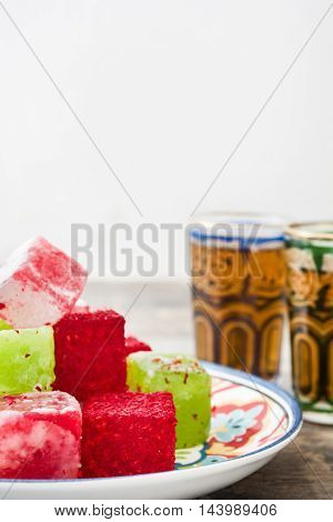 Turkish delights and tea on a wooden table