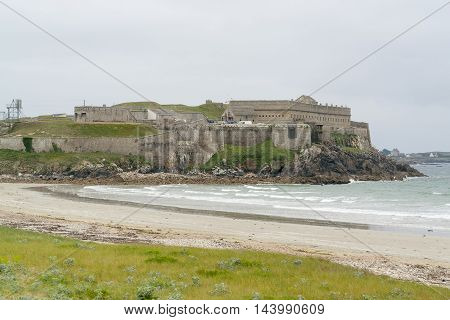 coastal scenery including a fortification near a commune named Quiberon in the Morbihan department in Brittany France