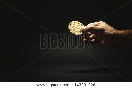 Male Hand Holding A Biscuit
