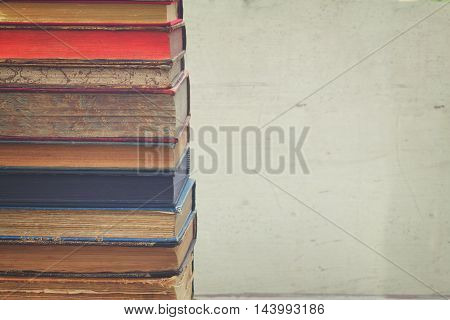 stack of books on white blank background close up, retro toned