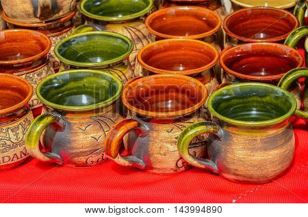colorful assortment of pitchers selling on market stall