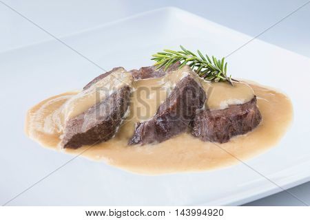 delicious traditional recipe from spain cheek on a white plate