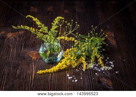Wild flowers in a bouquet on a wooden table