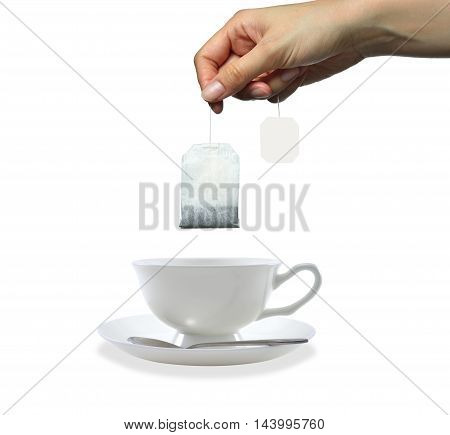 Woman's hand holding tea bag isolated on white background
