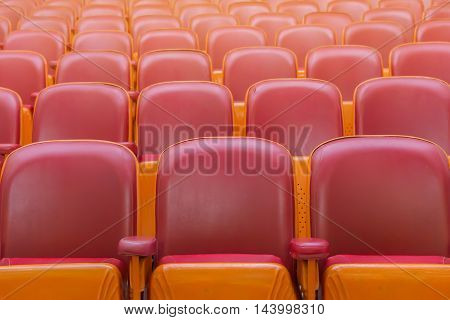 empty chairs in theatre or conference hall.