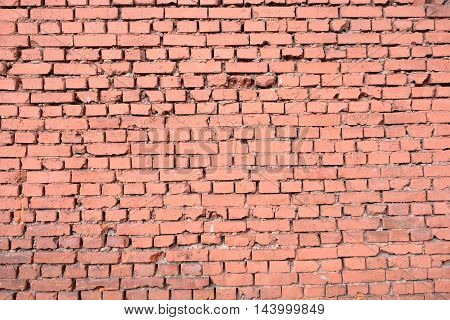 Old red brick wall as background horizontal view closeup