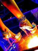 picture of night-club  - pretty woman legs on the glassy night club floor