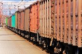 pic of boxcar  - Close view of freight train with boxcars passing railway station