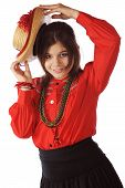 foto of senorita  - An attractive young senorita dancing with a straw hat - JPG