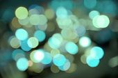Abstract background of watery blurred street lights poster