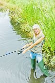 foto of fisherwomen  - woman fishing in pond in green spring country - JPG