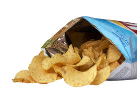 image of potato chips  - Pile of Potato Chips spilling from bag - JPG