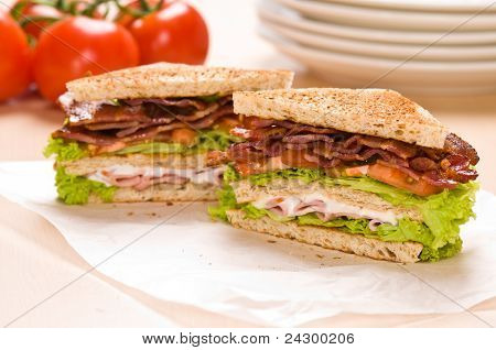 Two Sandwich On Wrapping Paper