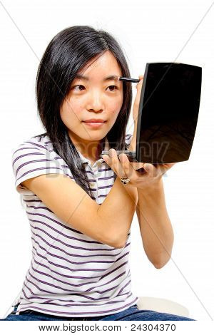Young Chinese Woman Putting On Makeup