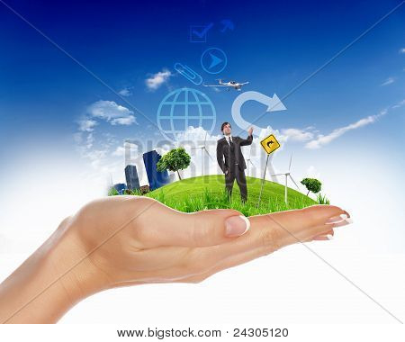 human hand holding a green city