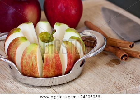 Freshly Sliced Apples And Cinnamon Sticks