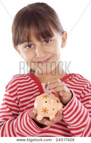 adorable girl putting its savings in your money box