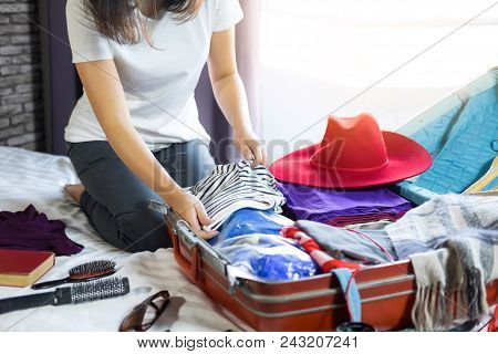 poster of Travel And Vacation Concept, Happiness Woman Packing Stuff And A Lot Of Clothes Into Suitcase On Bed