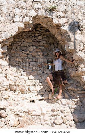 Girl near old wall