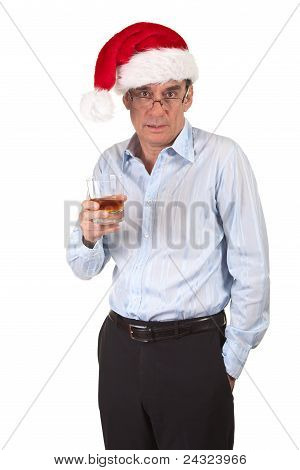 Slightly Drunk Business Man in Christmas Santa Claus Hat Holding Drink
