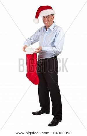 Happy Smiling Business Man in Santa Hat pleased with contents of Christmas Stocking