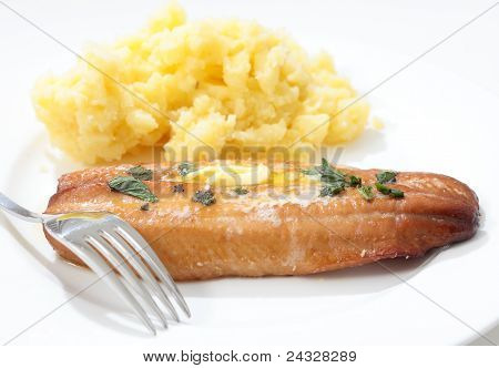 Grilled Kipper And Mashed Potato And Fork
