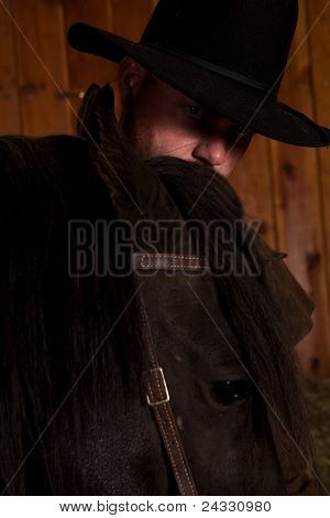 Cowboy Looking Over Horse Head