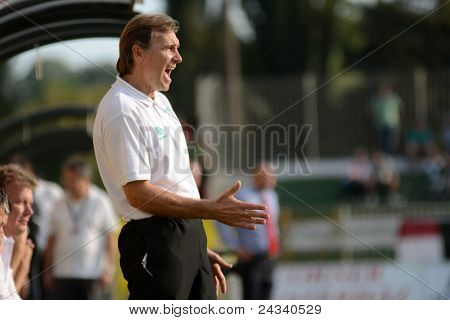 KAPOSVAR, HUNGARY - SEPTEMBER 24: Tibor Sisa (Kaposvar trainer) in action at a Hungarian Championship soccer game - Kaposvar (white) vs Debrecen (red) on September 24, 2011 in Kaposvar, Hungary.
