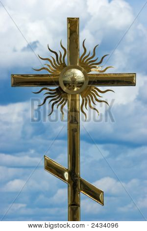 Cross With Reflection Of The Bell-Tower