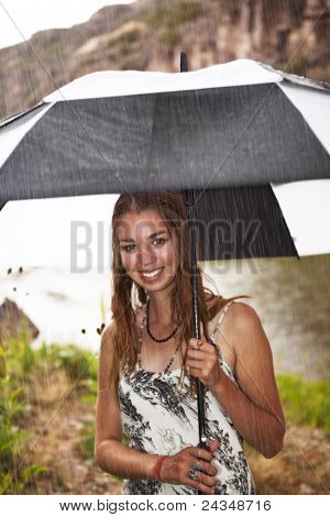 Smiling Girl In Summer Rain