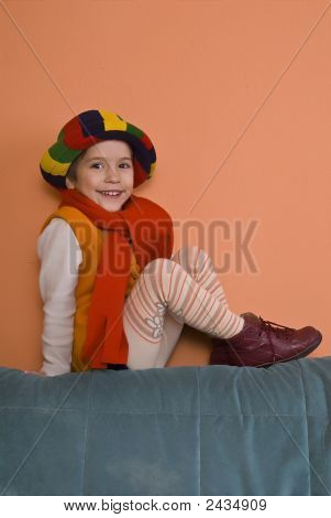 Litle Girl In Orange Dress Posing