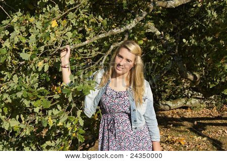 Girl Peeking Out from Oak Tree