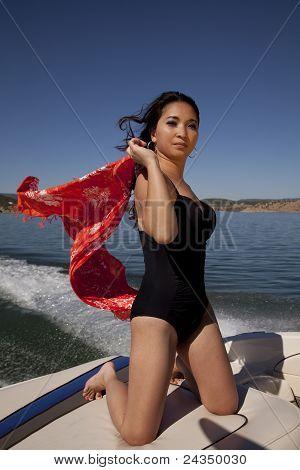 Woman Sarong Blowing Boat